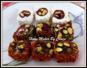 These are all  Pomegranate with honey and pistachio wrapped in marshmallow, wrapped  with crushed pistachio and wrapped with saffron