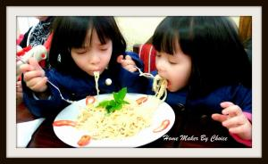Nana and Chacha enjoying their spaghetti