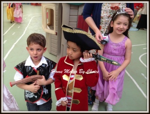 With his best friend Ahmad and a girl from KG2