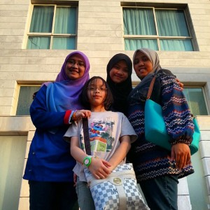 Picture in front of the house before leaving for airport